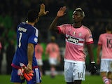 Juventus' goalkeeper Gianluigi Buffon and French midfielder Paul Pogba give high fives after the UEFA Champions League Group D, second-leg football match Borussia Moenchengladbach vs Juventus in Moenchengladbach, western Germany on November 3, 2015