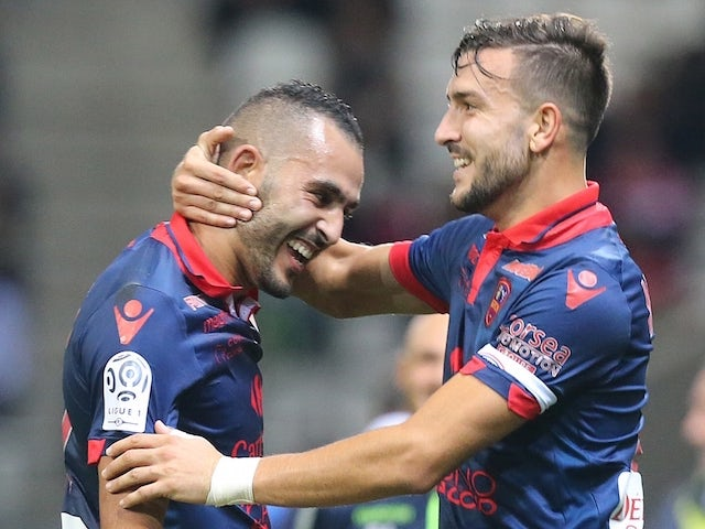 Ajaccio's French defender Pablo Martinez (R) congratulates his teammate French forward Khalid Boutaib after he scored a goal during the French L1 football match between Reims and Ajaccio on November 7, 2015 at the Auguste Delaune Stadium in Reims.