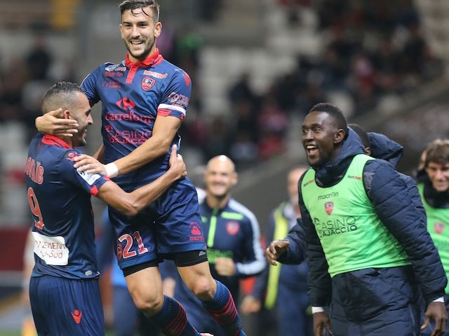 Ajaccio's French defender Pablo Martinez (2nd L) congratulates his teammate French forward Khalid Boutaib (L) after he scored a goal during the French L1 football match between Reims and Ajaccio on November 7, 2015 at the Auguste Delaune Stadium in Reims.