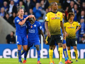 Ngolo Kante (2nd L) of Leicester City celebrates scoring his team's first goal with his team mate Danny Drinkwater (1st L) during the Barclays Premier League match between Leicester City and Watford at The King Power Stadium on November 7, 2015 in Leicest