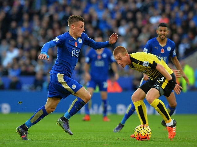 Jamie Vardy (C) of Leicester City and Ben Watson (R) of Watford compete for the ball during the Barclays Premier League match between Leicester City and Watford at The King Power Stadium on November 7, 2015 in Leicester, England.