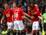 Cristiano Ronaldo of Manchester United celebrates with his team mates after scoring the opening goal; his 100th goal for Manchester United, during the Barclays Premier League match between Manchester United and Stoke City at Old Trafford on November 15, 2