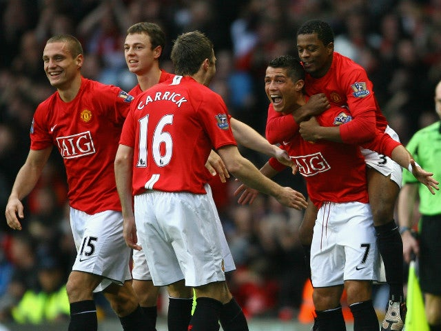 Cristiano Ronaldo Of Manchester United Celebrates With His Team Mates After Scoring The Opening Goal
