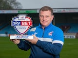 Scunthorpe United boss Mark Robins with League One's October Manager of the Month award
