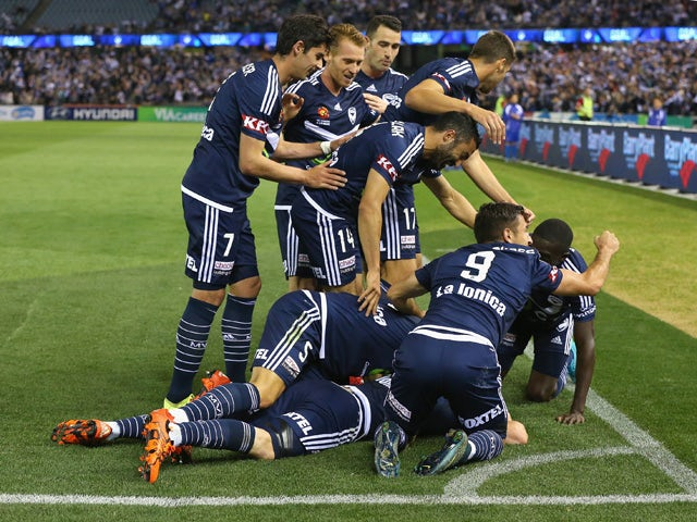 Besart Berisha of the Victory is congratulated by team mates after scoring a goal during the round four A-League match between the Melbourne Victory and Wellington Phoenix at Etihad Stadium on November 2, 2015