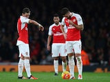 Mesut Oezil of Arsenal (L) and Olivier Giroud of Arsenal look dejected after conceding a goal during the Barclays Premier League match between Arsenal and Tottenham Hotspur at the Emirates Stadium on November 8, 2015 in London, England.