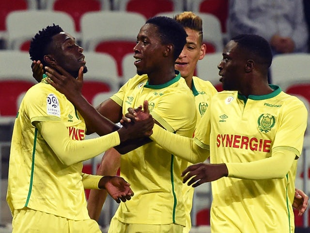 Nantes' forward Alexis Alegue Elandi (L) celebrates with teammates after scoring a goal during the French Ligue 1 football match between Nice and Nantes, on November 4, 2015