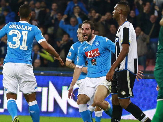 Napoli's Argentinian-French forward Gonzalo Higuain (C) celebrates after scoring during the Italian Serie A football match SSC Napoli vs Udinese Calcio on November 8, 2015