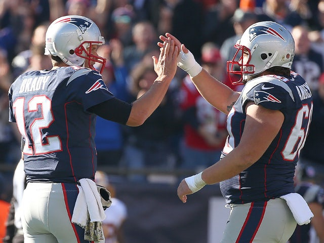 Tom Brady #12 of the New England Patriots celebrates a touchdown with David Andrews #60 in the first quarter against the Washington Redskins at Gillette Stadium on November 8, 2015