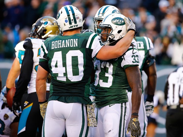 Chris Ivory #33 of the New York Jets is congratulated by his teammate Tommy Bohanon #40 after scoring a third quarter touchdown against the Jacksonville Jaguars Stadium on November 8, 2015