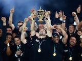 New Zealand's flanker and captain Richie McCaw (C) celebrates with the Webb Ellis Cup after winning the 2015 Rugby World Cup at Twickenham stadium, South-West London, on October 31, 2015