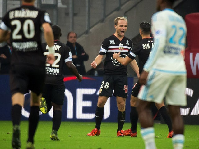 Nice's French forward Valere Germain (Rear C) celebrates with teammate Nice's French forward Hatem Ben Arfa after scoring during the French L1 football match Olympique de Marseille vs Nice on November 8, 2015