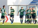 Nicola Sansone of Sassuolo Calcio celebrates with their team mate's after scoring his openig goal during the Serie A match between US Sassuolo Calcio and Carpi FC at Mapei Stadium - Città del Tricolore on November 8, 2015 in Reggio nell'Emilia, Italy.