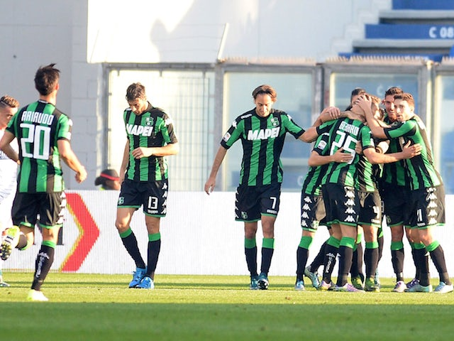 Nicola Sansone of Sassuolo Calcio celebrates with their team mate's after scoring his openig goal during the Serie A match between US Sassuolo Calcio and Carpi FC at Mapei Stadium - Citt� del Tricolore on November 8, 2015 in Reggio nell'Emilia, Italy.