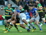 Mako Vunipola of Saraces is tackled by George North during the Aviva Premiership match between Northampton Saints and Saracens at Franklin's Gardens on November 7, 2015 in Northampton, England.