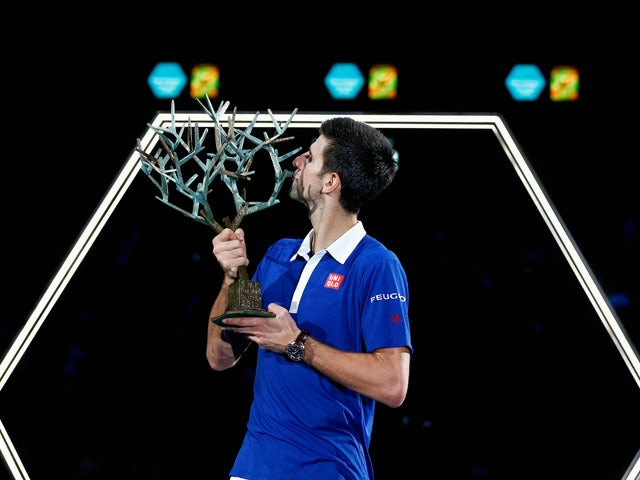 Novak Djokovic of Serbia poses with the trophy after victory against Andy Murray of Great Britain in their Mens Final match during Day 7 of the BNP Paribas Masters held at AccorHotels Arena on November 8, 2015