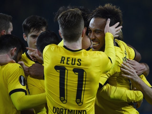 Dortmund's Gabonese striker Pierre-Emerick Aubameyang (R) celebrates scoring with his team-mates during the UEFA Europa League football match Borussia Dortmund vs Qabala FK, in Dortmund, western Germany on November 5, 2015.