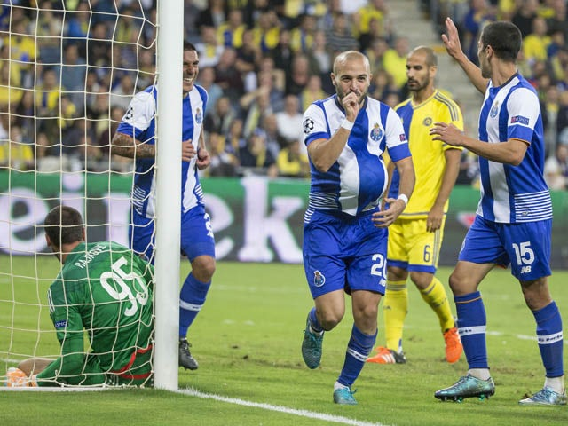 Porto's Portuguese midfielder Andre Andre (C) reacts after scoring during the UEFA Champions League, group G, football match between Maccabi Tel Aviv and FC Porto at the Sammy Ofer Stadium, in the Israeli coastal city of Haifa, on November 04, 2015