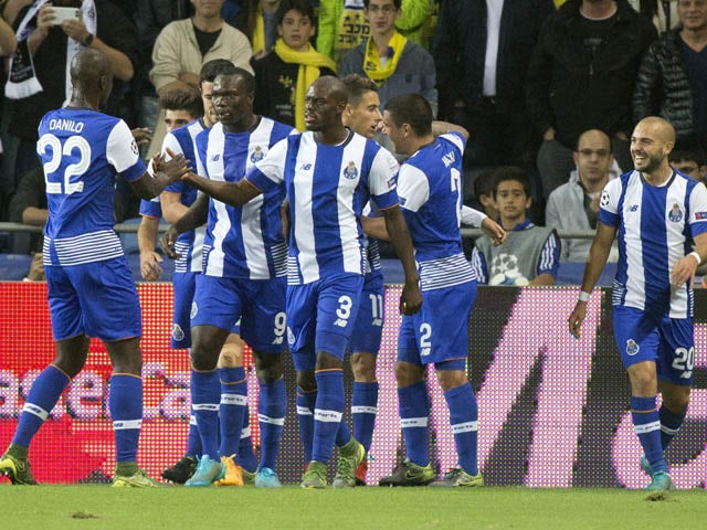 FC Porto's players celebrate after scoring during the UEFA Champions League, group G, football match between Maccabi Tel Aviv and FC Porto at the Sammy Ofer Stadium, in the Israeli coastal city of Haifa, on November 4, 2015