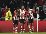 PSV Eindhoven's Dutch forward Jurgen Locadia (C) celebrates with his teammates after scoring during the UEFA Champions League football match PSV Eindhoven vs VfL wolfsburg at the Philips Stadion stadium in Eindhoven on November 3, 2015