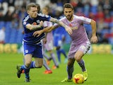 Orlando Sa of Reading is tackled by Aron Gunnarsson of Cardiff City during the Sky Bet Championship match between Cardiff City and Reading at the Cardiff City Stadium on November 7, 2015 in Cardiff, Wales.