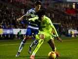 Philip Billing of Huddersfield holds off pressure from Lucas Piazon of Reading during the Sky Bet Championship match between Reading and Huddersfield Town on November 3, 2015