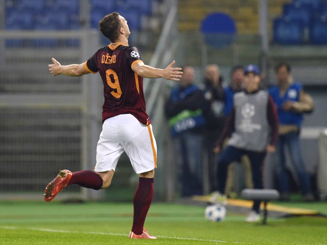 Roma's forward from Bosnia-Herzegovina Edin Dzeko celebrates after scoring during the UEFA Champions League football match AS Roma vs Bayer Leverkusen on November 4, 2015