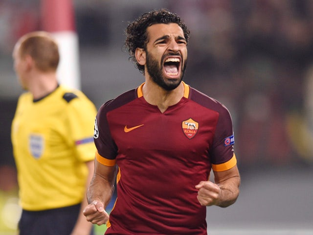 Roma's midfielder from Egypt Mohamed Salah celebrates after scoring during the UEFA Champions League football match AS Roma vs Bayer Leverkusen on November 4, 2015