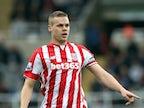 Stoke City play down seriousness of Ryan Shawcross's back injury