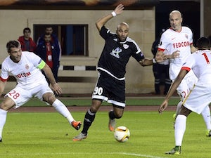 Monaco salvage draw to extend Group J lead