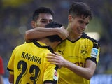 Dortmund's Japanese midfielder Shinji Kagawa (L) and Dortmund's midfielder Julian Weigl (R) celebrate after their first goal during the German first division football Bundesliga match Borussia Dortmund vs FC Schalke 04 on November 8, 2015, 2015 in Dortmun