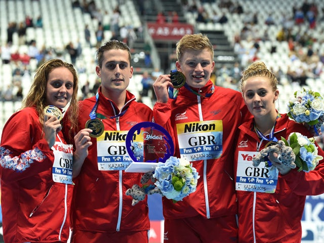 Fran Halsall, Chris Walker-Hebborn, Adam Peaty and Siobhan-Marie O'Connor of Great Britain pose during the medal ceremony for the Mixed 4x100m Medley Relay Final on day twelve of the 16th FINA World Championships at the Kazan Arena on August 5, 2015