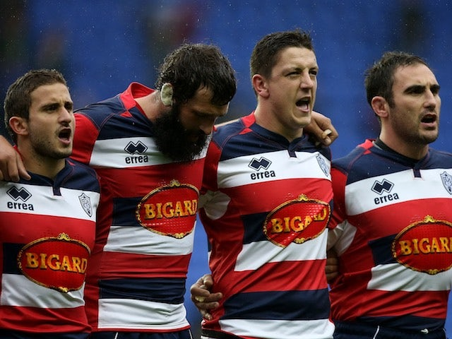 Agen players sing the French national anthem, 'La Marseillaise', during a minute's silence on November 14, 2015 for the Paris terror attacks