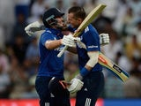Alex Hales celebrates with England teammate Joe Root after making his maiden ODI century against Pakistan in Abu Dhabi on November 13, 2015