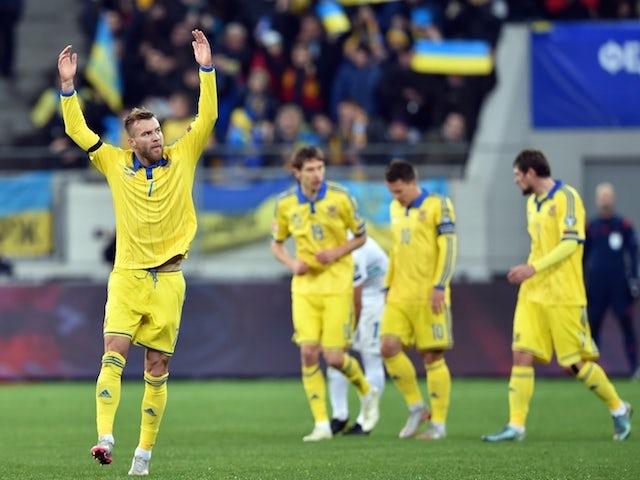 Ukraine's Andriy Yarmolenko (L) celebrates after scoring against Slovenia in the Euro 2016 play-off football match between Ukraine and Slovenia at the Arena Lviv stadium in Lviv on November 14, 2015.