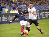 French defender Bacary Sagna (L) vies with Germany's defender Jonas Hector during a friendly international football match between France and Germany ahead of the Euro 2016, on November 13, 2015 at the Stade de France stadium in Saint-Denis, north of Paris