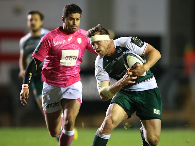 Brendon O'Connor of Leicester breaks away from Morne Steyn during the Eurpean Rugby Champions Cup match between Leicester Tigers and Stade Francais at Welford Road on November 13, 2015 in Leicester, England.