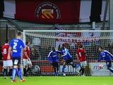 Gboly Ariyibi of Chesterfield (28) celebrates as he scores their first goal during the Emirates FA Cup first round match between FC United of Manchester and Chesterfield at Broadhurst Park on November 9, 2015