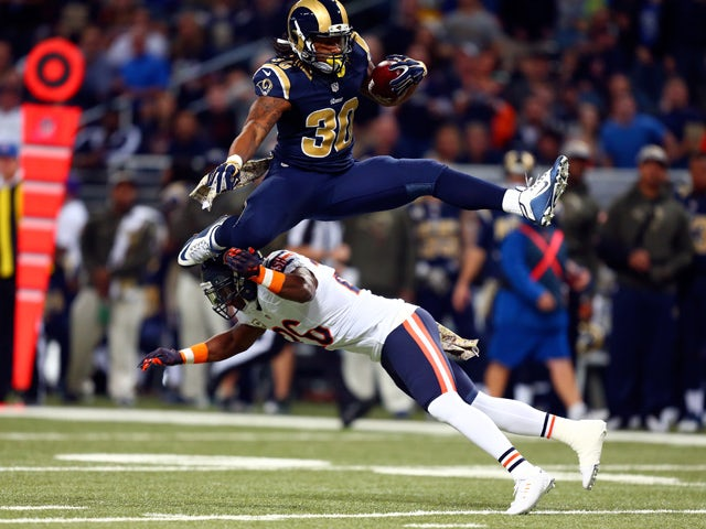 Todd Gurley #30 of the St. Louis Rams leaps over Antrel Rolle #26 of the Chicago Bears as he carries the ball in the first quarter at the Edward Jones Dome on November 15, 2015