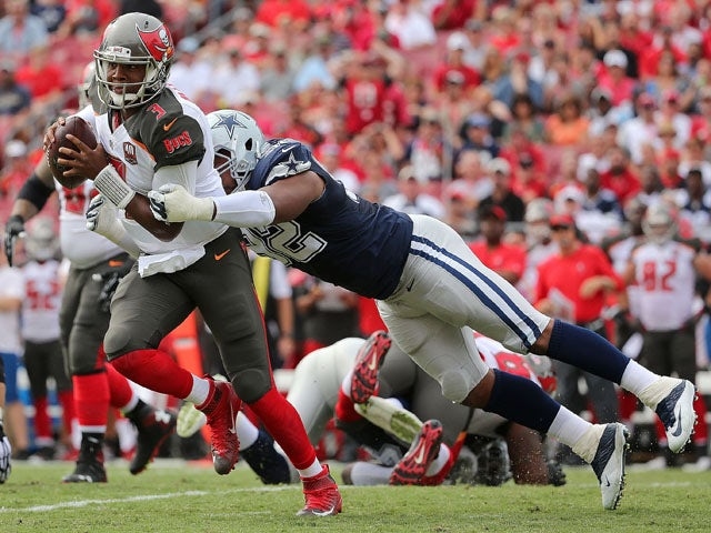 Jameis Winston #3 of the Tampa Bay Buccaneers escapes a tackle from Jeremy Mincey #92 of the Dallas Cowboys during a game at Raymond James Stadium on November 15, 2015