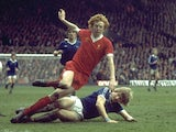 David Fairclough of Liverpool is tackled by an Everton player during a Football League Division One match at Anfield in Liverpool in Apirl, 1977