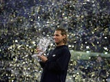 David Nalbandian of Argentina holds the trophy after his five set victory against Roger Federer of Switzerland in the final of the ATP Masters Cup on November 20, 2005 at the Qi Zhong Stadium in Shanghai, China.