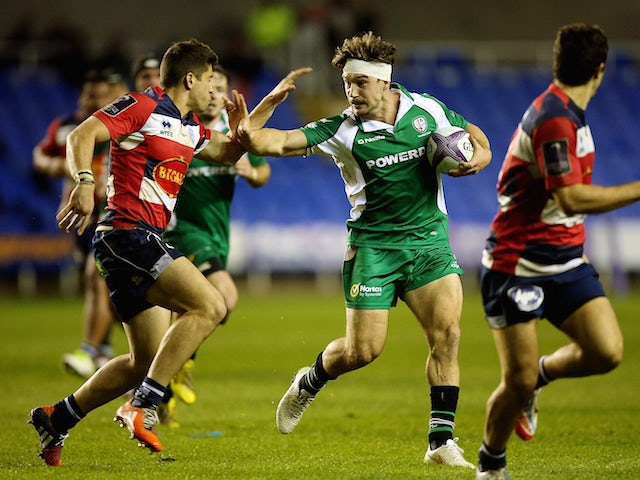 Dominic Waldouck of London Irish hands off the tackle of Julien Heriteau of Agen during the European Rugby Challenge Cup match between London Irish and Agen at Madejski Stadium on November 14, 2015 in Reading, England.