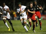 Duncan Taylor of Saracens breaks away from Thierry Dusautoir during the European Rugby Champions Cup match between Saracens and Toulouse at Allianz Park on November 14, 2015 in Barnet, England.