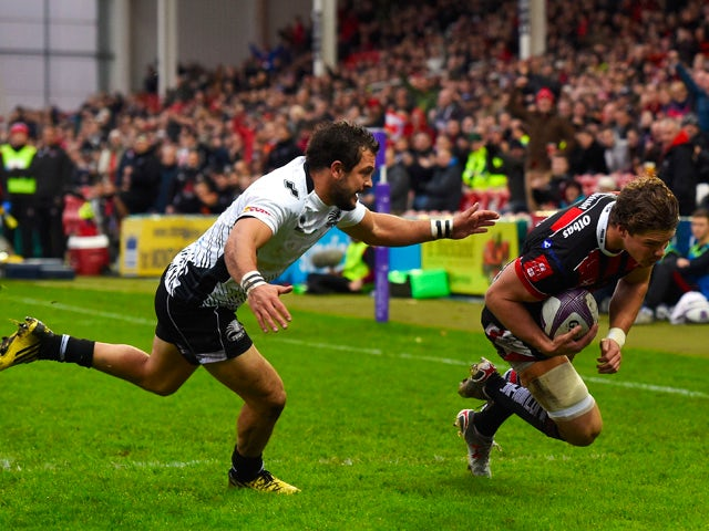 Gloucester wing Henry Purdy crosses for the first try as Zebra fullback Guglielmo Palazzani looks on during the European Rugby Challenge Cup match between Gloucester and Zebra at Kingsholm Stadium on November 14, 2015