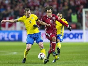 Sweden 9 Kim Kallstrom and Sweden 5 Martin Olsson against Denmark 8 Martin C. Braithwaite during a European Qualifier Play-Off between Sweden and Denmark on November 14, 2015 in Solna, Sweden.