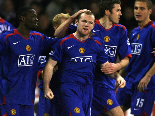 Manchester United's Wayne Rooney is congratulated after scoring against Sheffield United during their English Premiership football match at Bramall Lane, Sheffield, England, November 18 2006