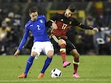 Italy's Mattia De Sciglio (L) vies for the ball with Belgium's midfielder Yannick Carrasco (R) during the friendly football match between Belgium and Italy, at the King Baudouin Stadium, on November 13, 2015 in Brussels.