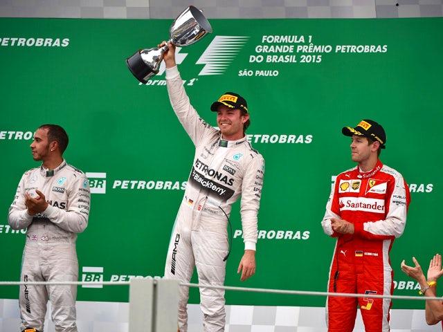 Mercedes' Formula One German driver Nico Rosberg (C) celebrates after winning the Brazilian Grand Prix, at the Interlagos racetrack in Sao Paulo, on November 15, 2015