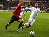 Norway's captain Per Ciljan Skjelbred and Hungary's defender Attila Fiola vie for the ball during the first-leg play off qualifier football match for the UEFA 2016 European Championship in France on Novemebr 12, 2016 in Oslo, Norway.